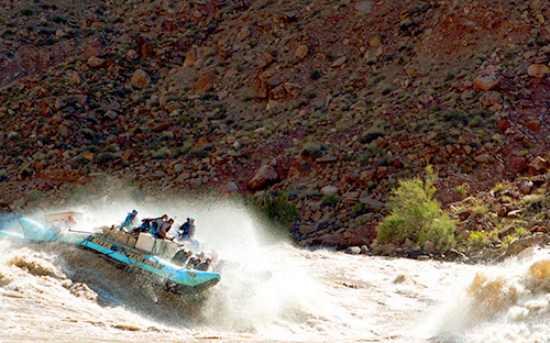White water rafting in a huge rapid through Cataract Canyon